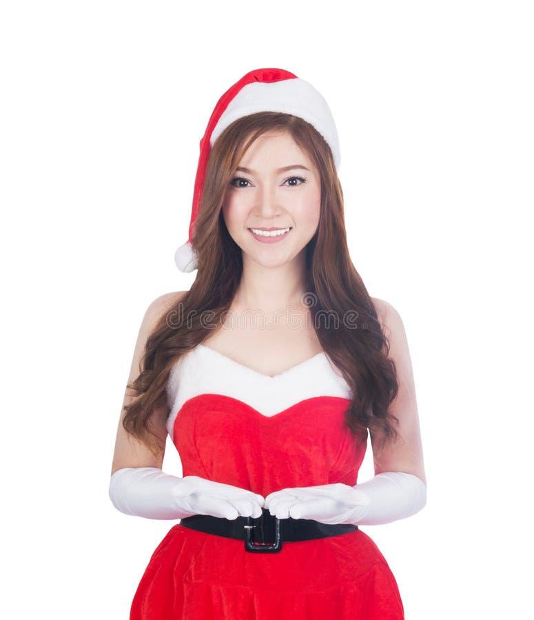 Femme de Noël tenant quelque chose souriant photo stock