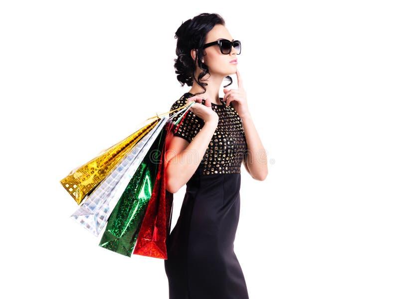 Femme de pensée en robe et verres noirs photographie stock