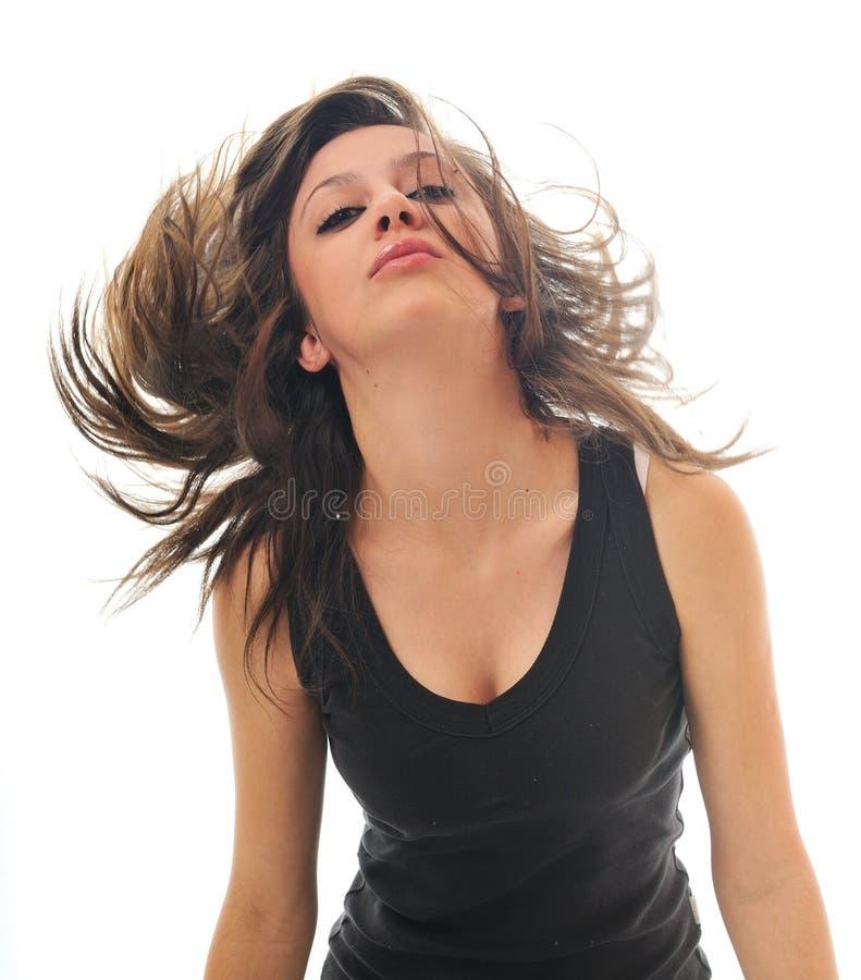 Femme de réception d'isolement avec le vent dans le cheveu photos stock