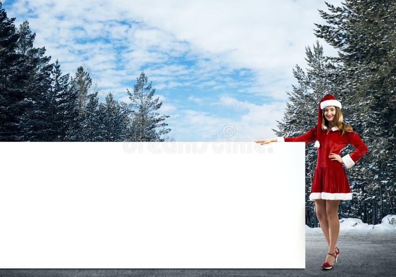 Femme de Santa avec la bannière photo libre de droits