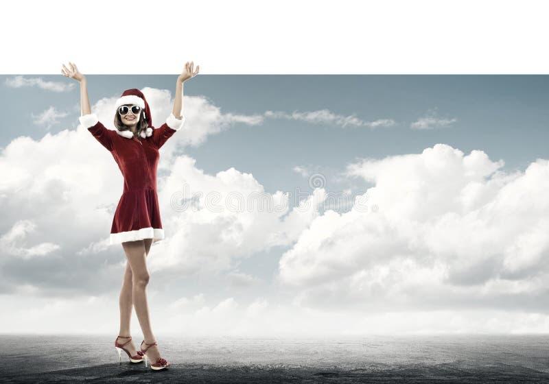 Femme de Santa avec la bannière image libre de droits