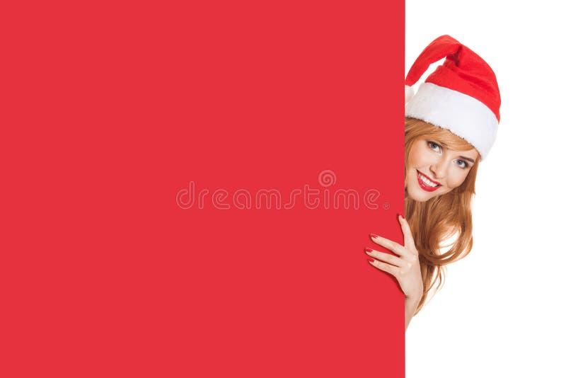 Femme de Santa et bannière de papier rouge photographie stock