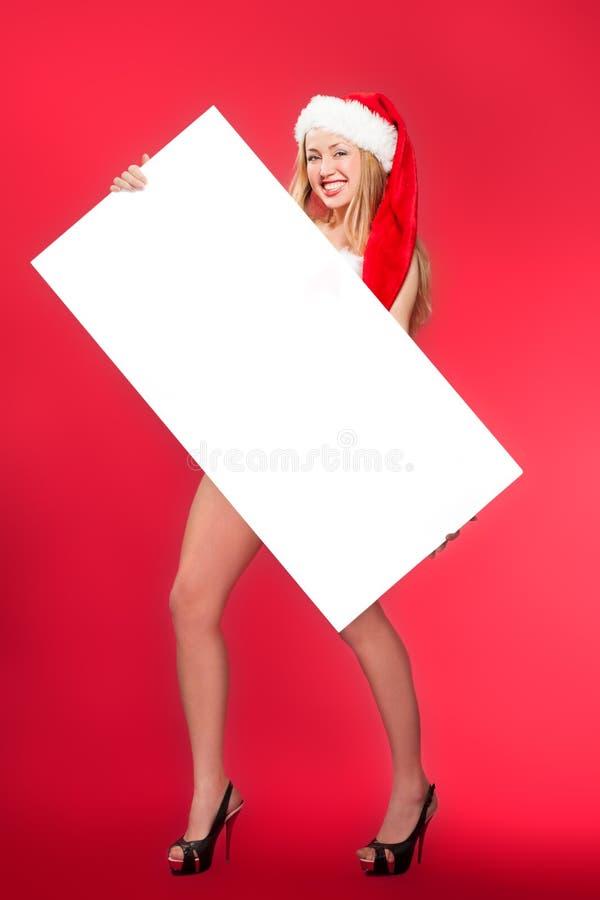 Femme de Santa se dirigeant au tableau blanc vide photo stock