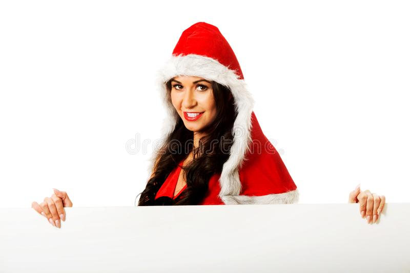 Femme de Santa tenant la bannière blanche images stock