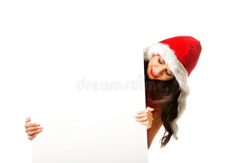 Femme de Santa tenant la bannière blanche image libre de droits