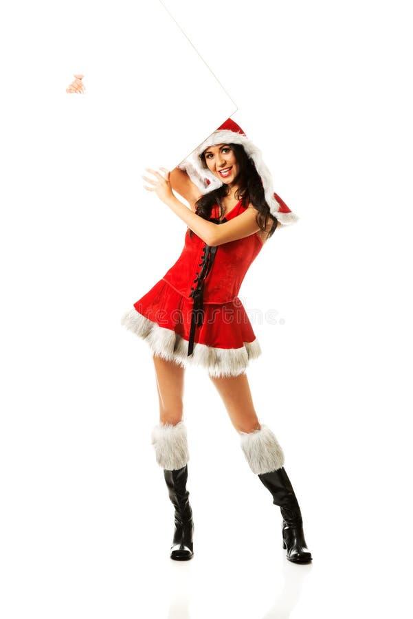 Femme de Santa tenant la bannière vide images libres de droits