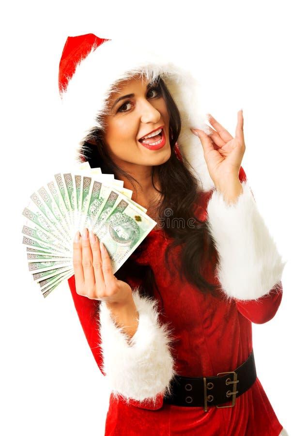 Femme de Santa tenant une agrafe d'argent polonais photos stock