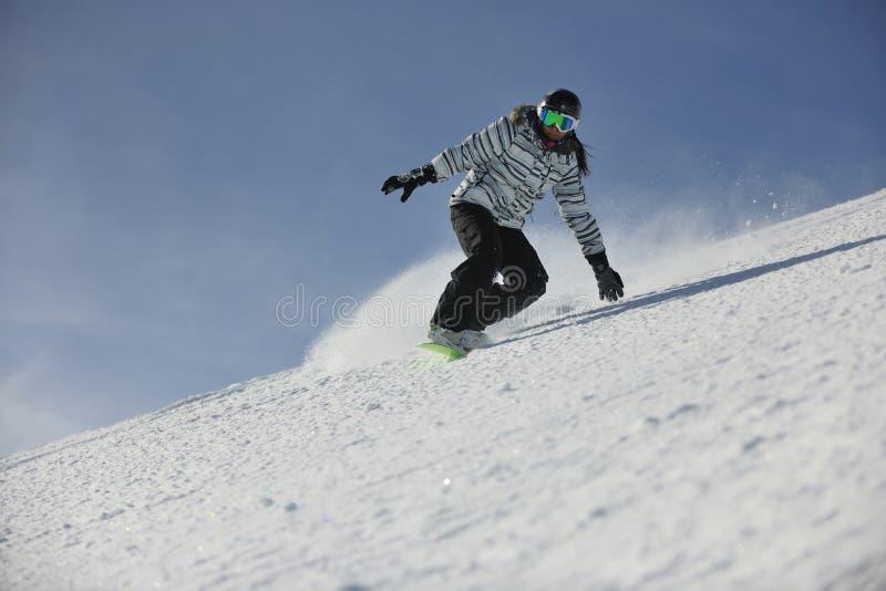 Femme de Snowboard photographie stock