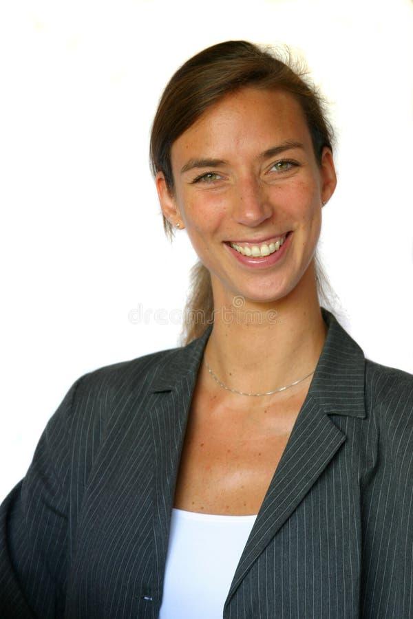 Femme de sourire attirante d'affaires image stock