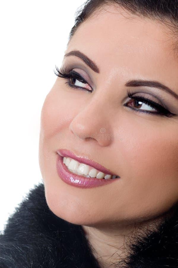 Femme de sourire avec le renivellement images stock