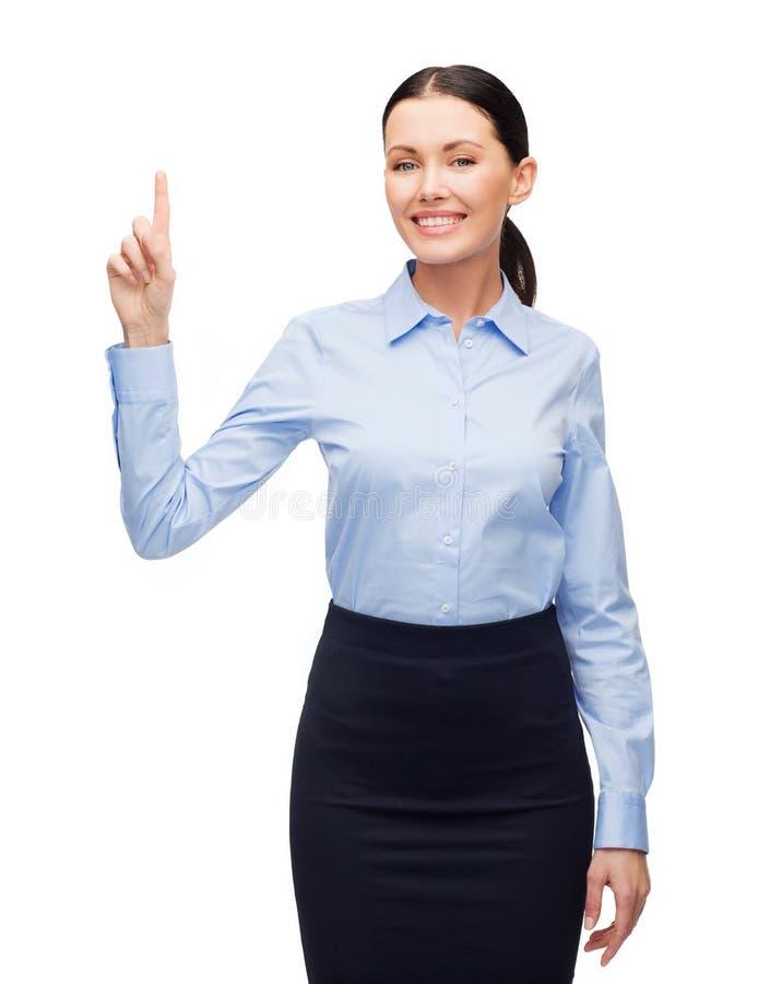 Femme de sourire avec son doigt  photographie stock libre de droits