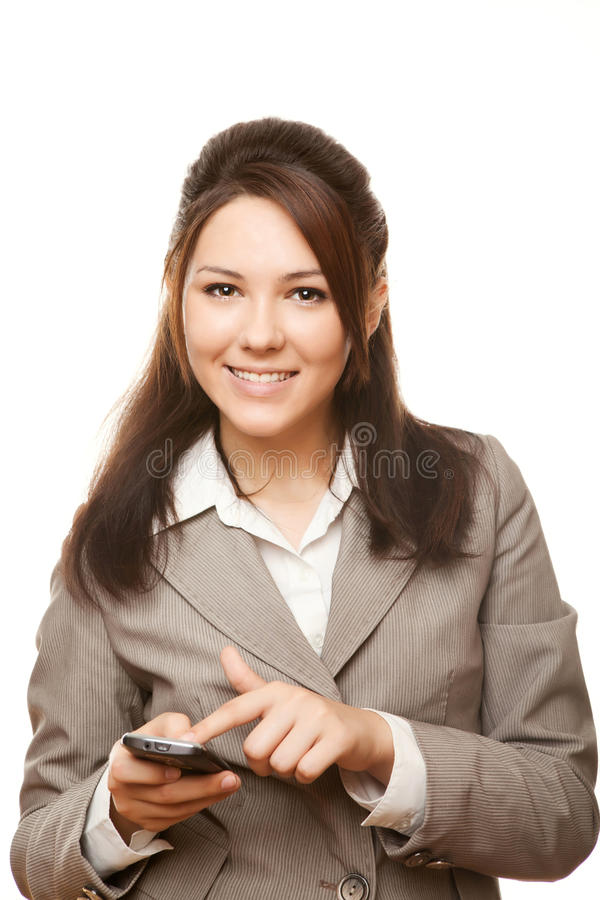 Femme de sourire d'affaires avec le téléphone portable photo stock
