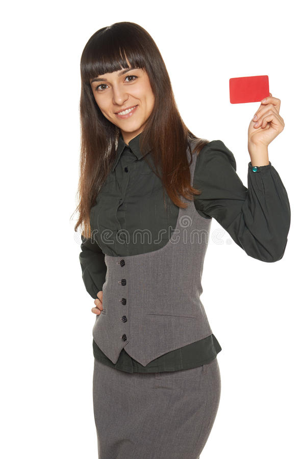 Femme de sourire d'affaires tenant la carte de crédit images stock