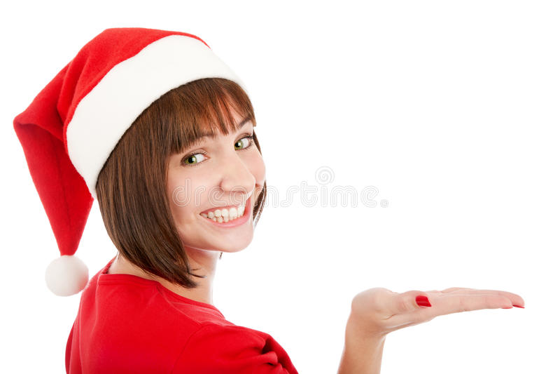 Femme de sourire dans le chapeau de Santa présentant votre produit images libres de droits