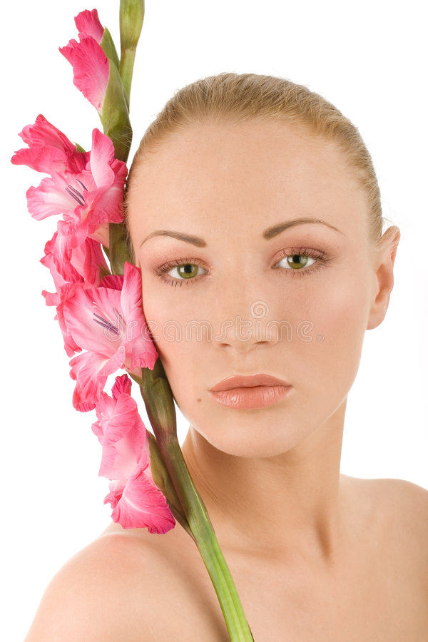 Femme de station thermale avec le gladiolus images stock