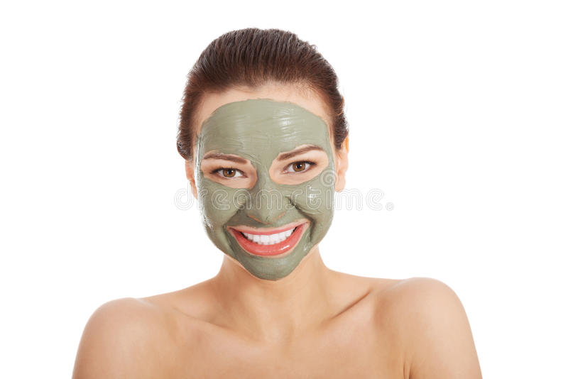 Femme de toplessl de Beautifu avec le masque facial. photo stock
