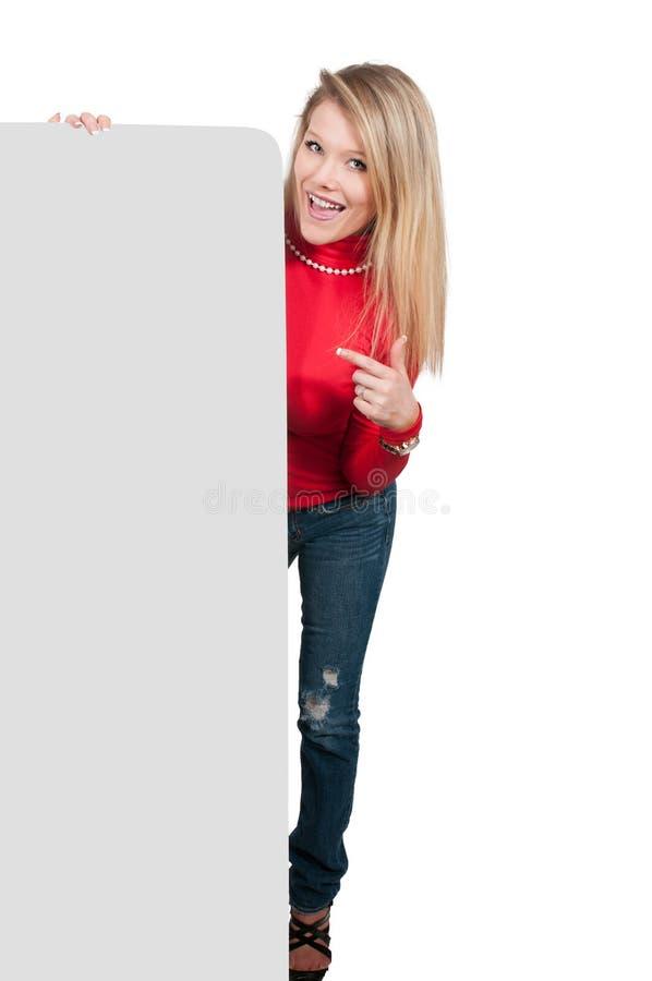 Femme derrière un affichage image stock