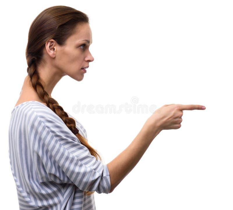 Femme dirigeant son doigt dans le côté photo stock