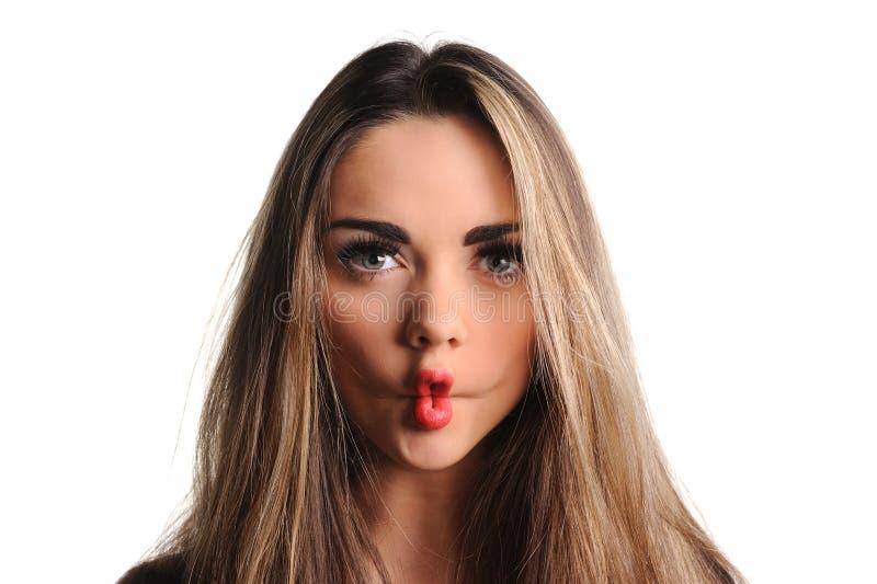 Femme effectuant un visage drôle photographie stock