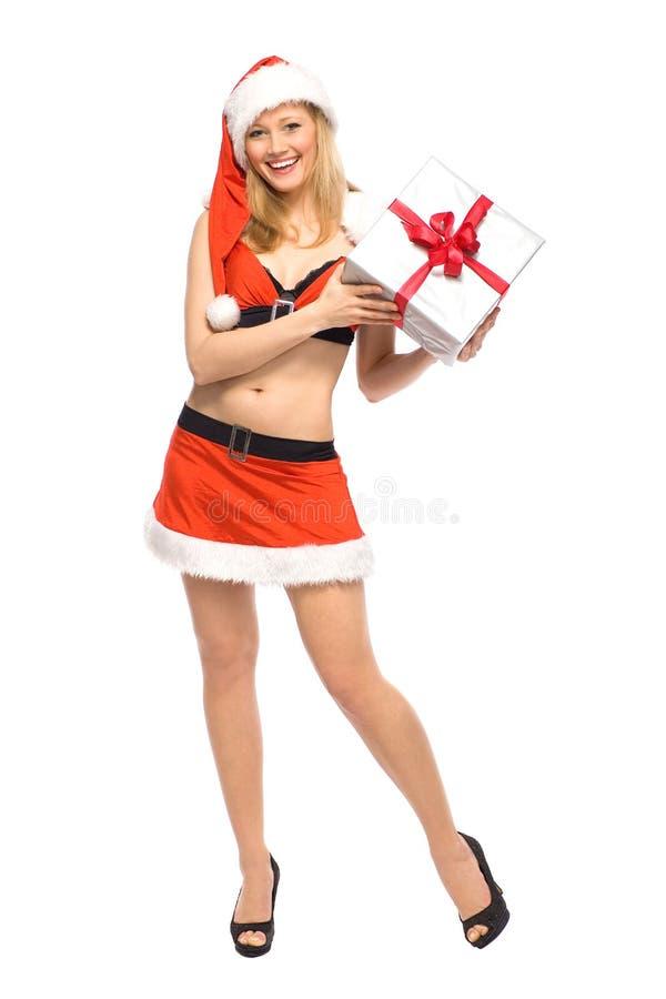 Femme en cadeau de fixation de costume de Santa photographie stock libre de droits