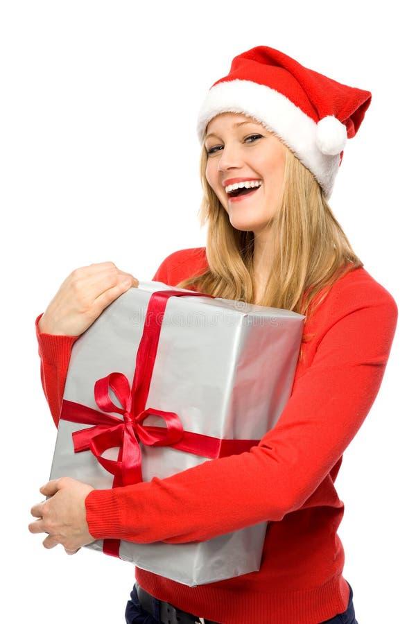 Femme en cadeaux de fixation de chapeau de Santa photo stock