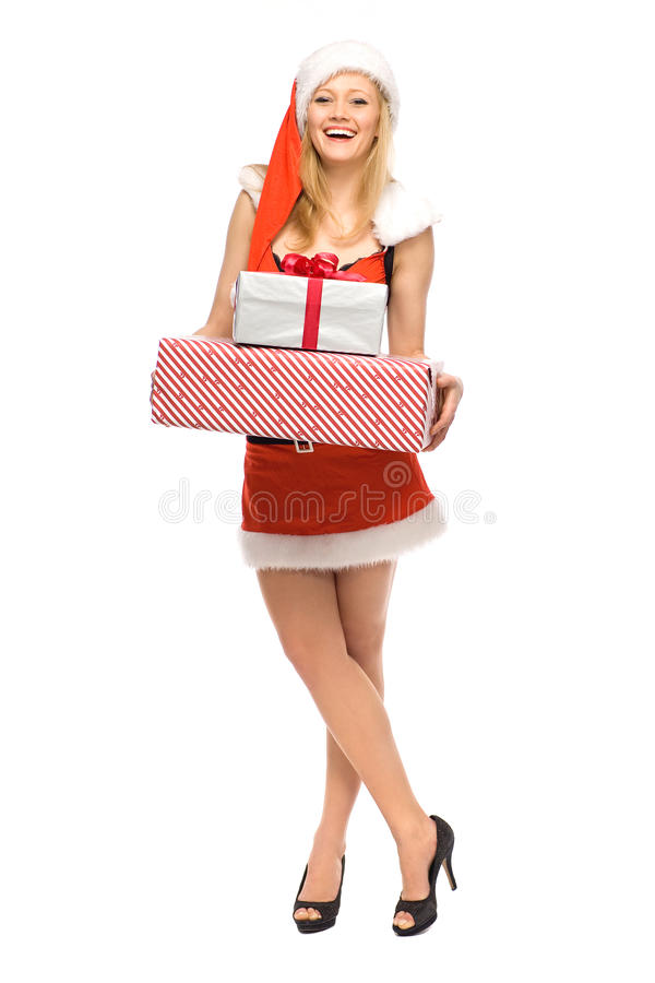 Femme en cadeaux de fixation de costume de Santa photo libre de droits