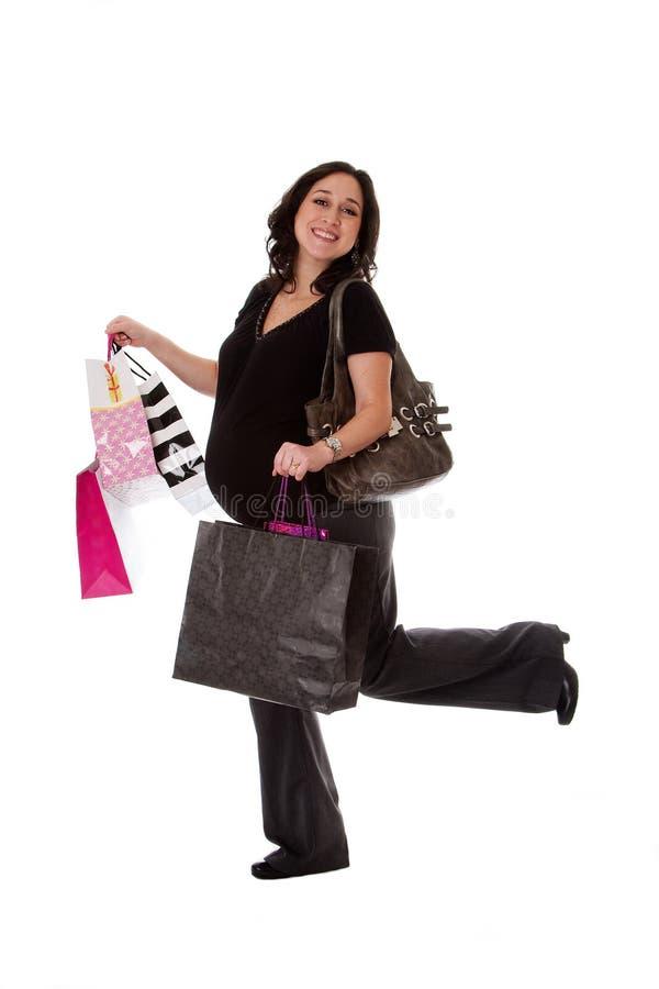 Femme enceinte avec des sacs à provisions photo libre de droits