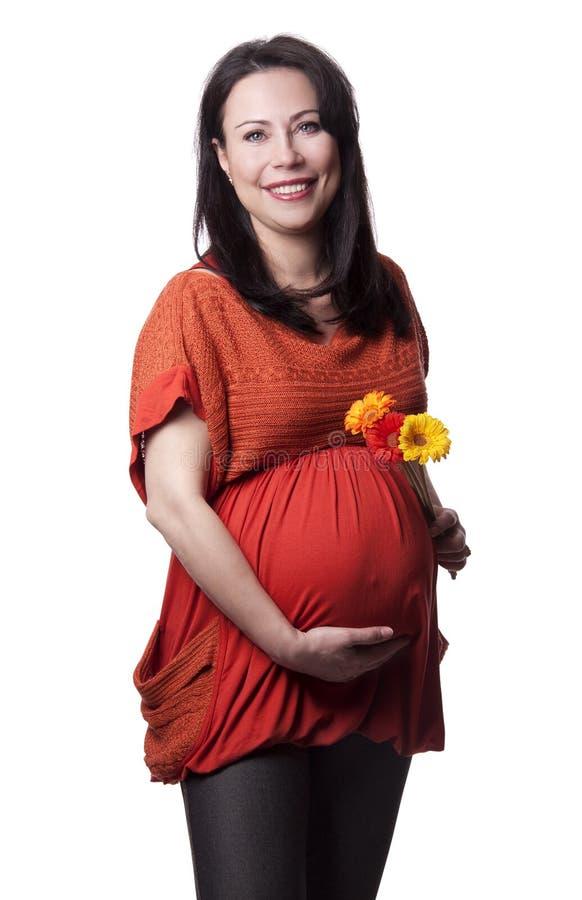 Femme enceinte d'adulte avec des fleurs photo stock