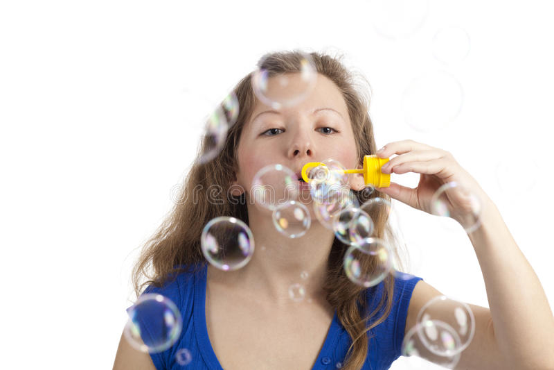 Femme espiègle avec des bulles photographie stock