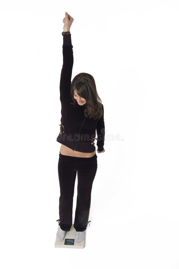 Femme et échelle image libre de droits