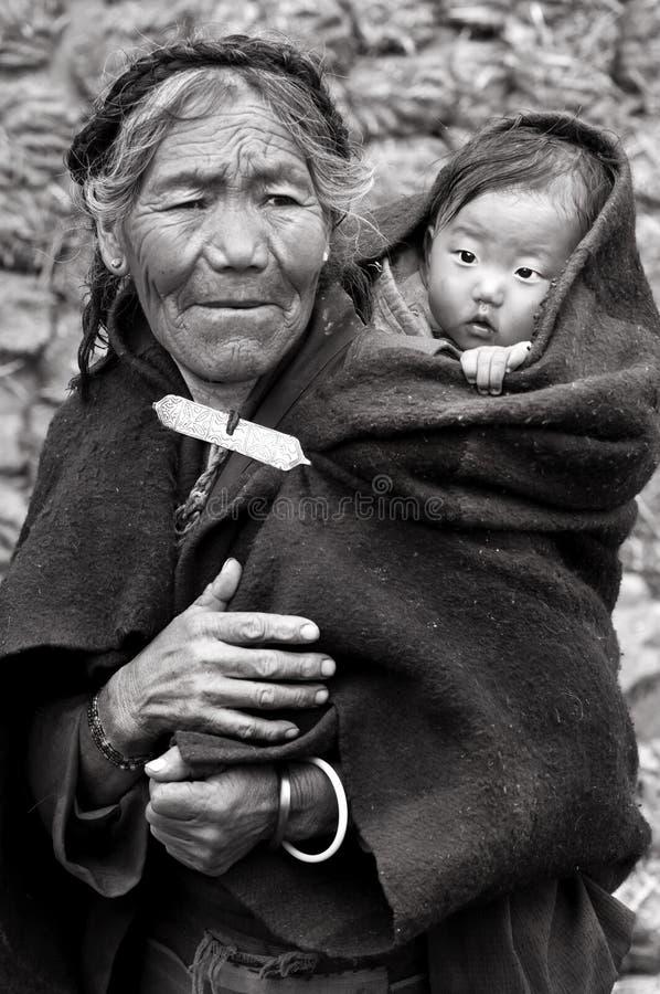 Femme et enfant tibétains image libre de droits