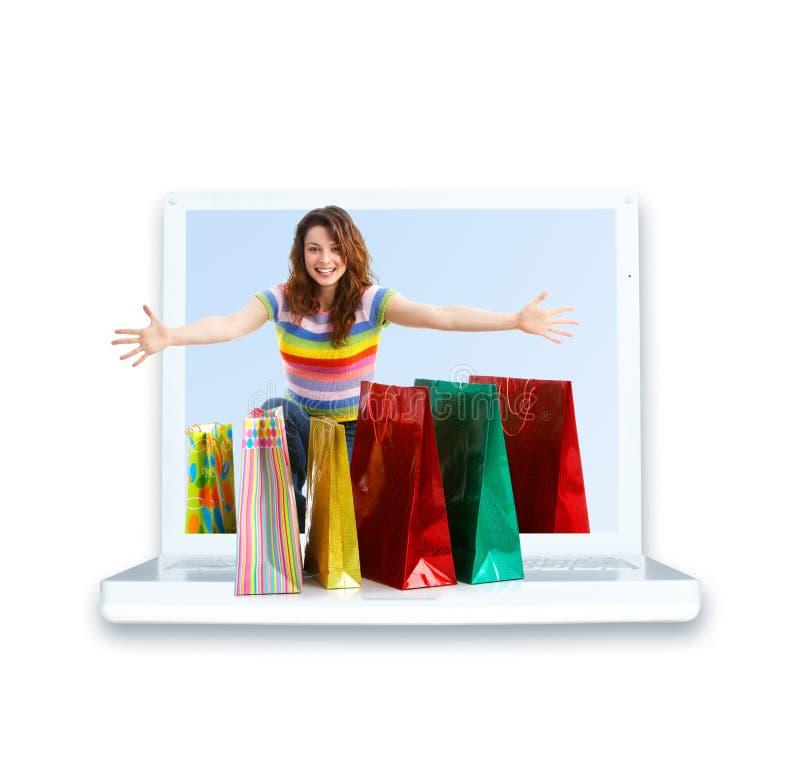 Femme et ordinateur portatif d'achats image libre de droits