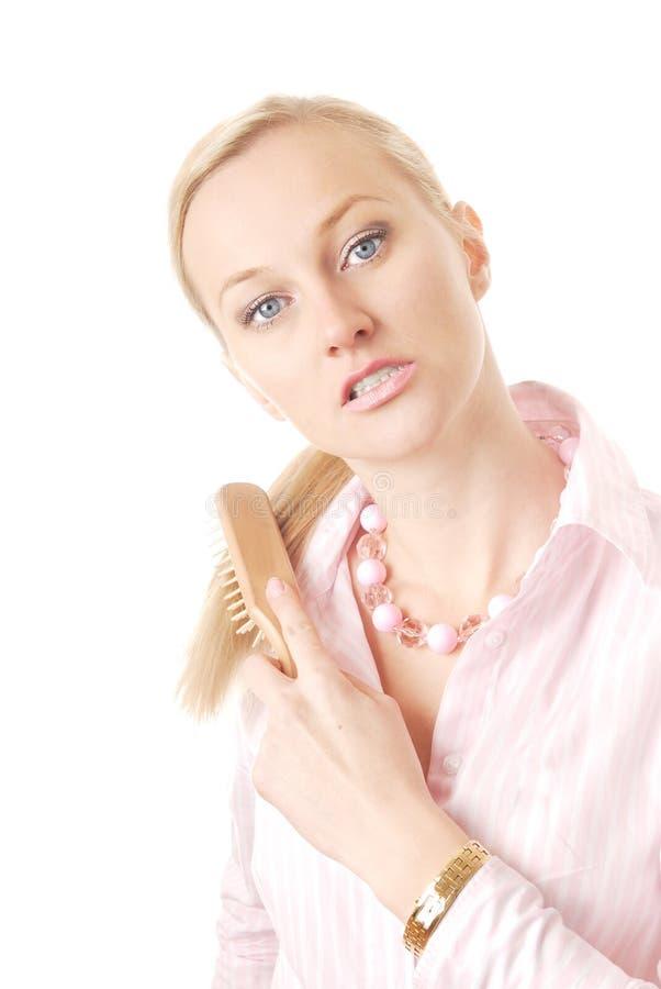 Femme et râteau-peigne images stock