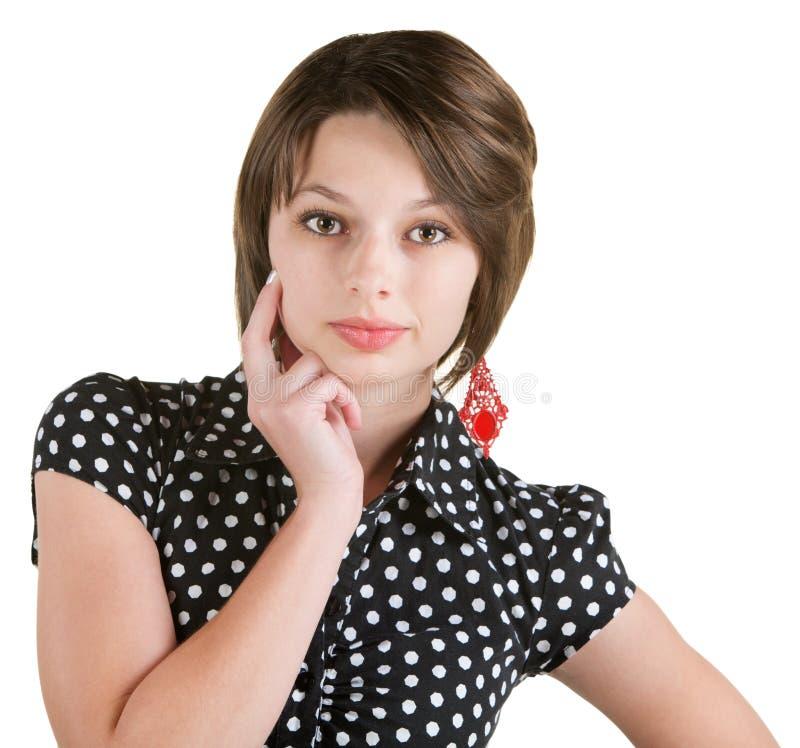 Femme sérieuse avec le doigt sur la joue image libre de droits