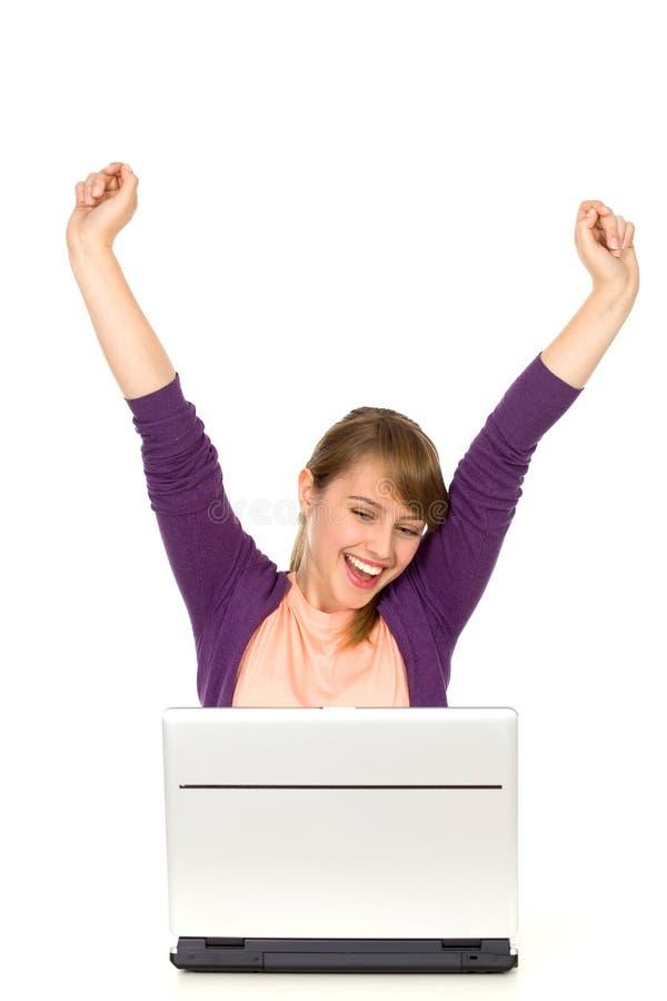 Femme Excited Avec L Ordinateur Portatif Photographie stock libre de droits