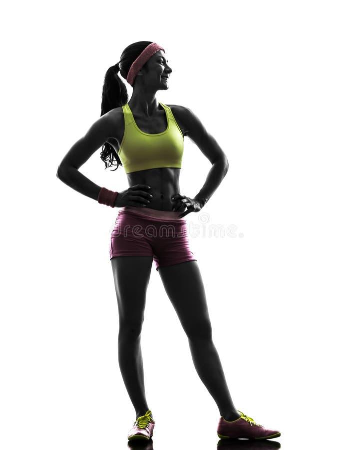Femme exerçant la forme physique se tenant semblante la silhouette partie images libres de droits