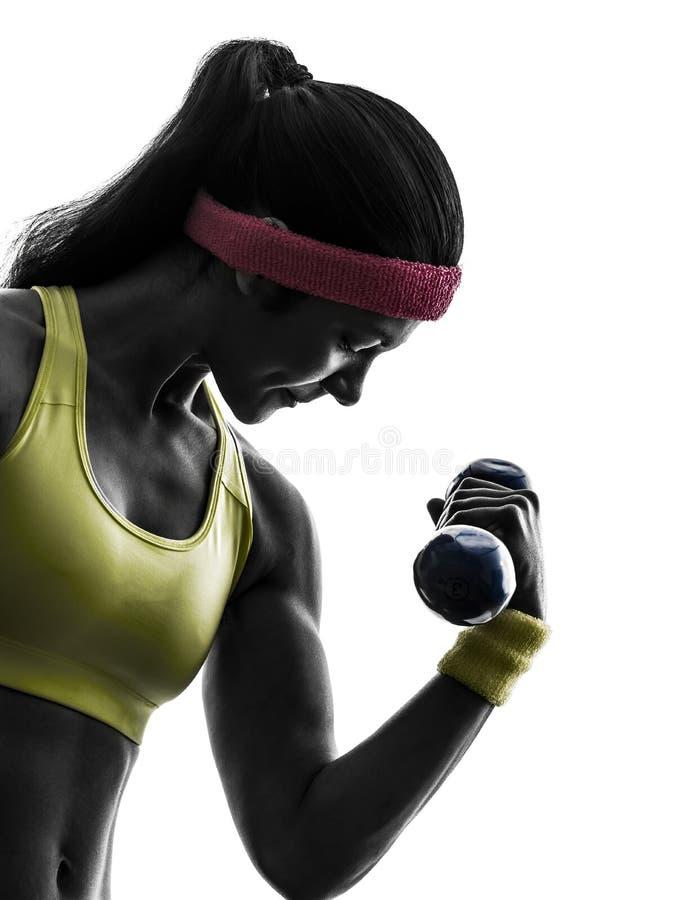 Femme exerçant la silhouette de formation de poids de séance d'entraînement de forme physique images libres de droits