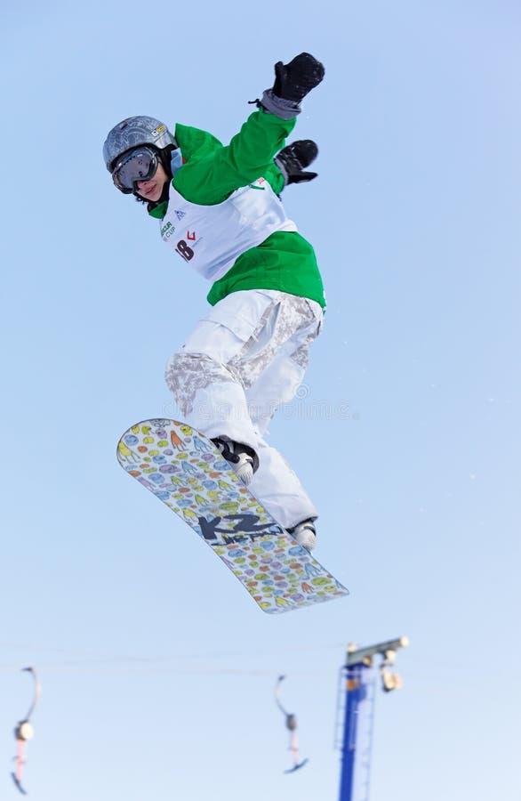 femme extrême de snowboard de mouche image stock
