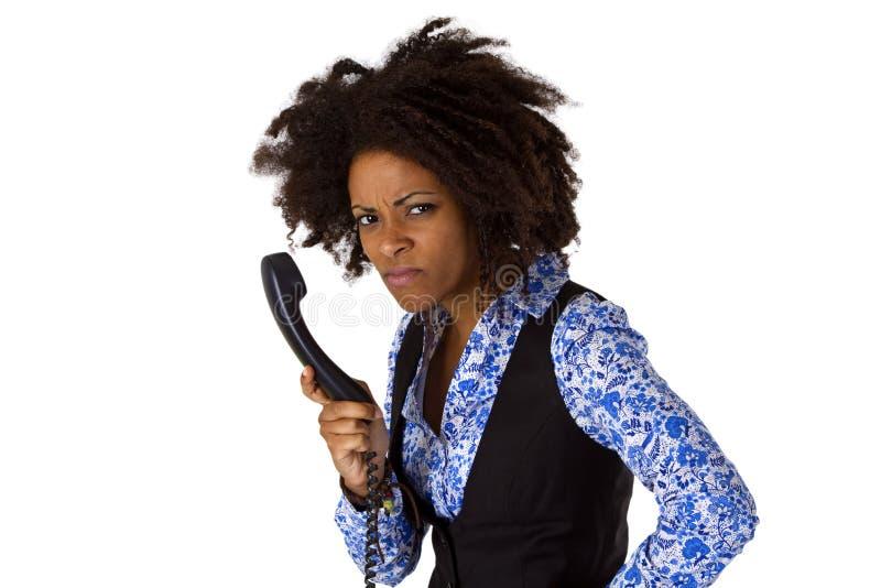 Femme fâchée d'afro-américain avec le combiné téléphonique images stock