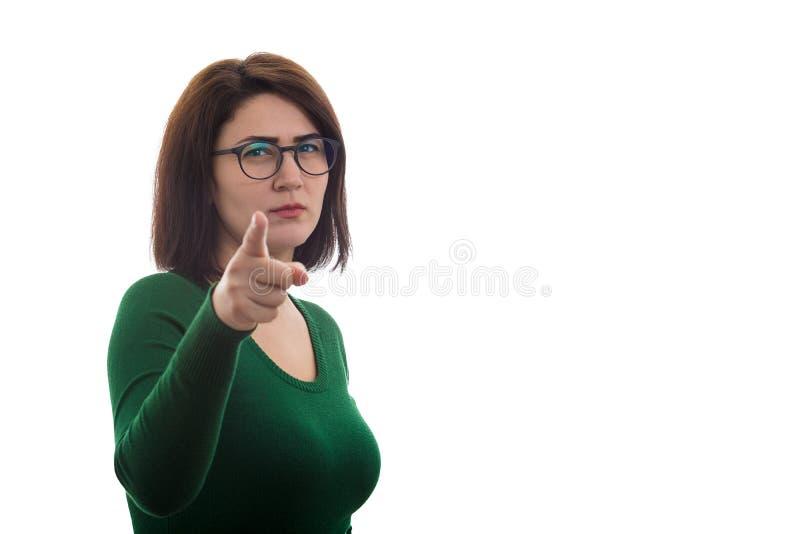 Femme fâchée indiquant vous photo stock