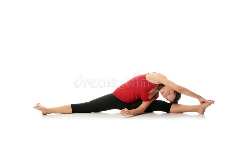 Femme faisant étirant l'exercice image libre de droits