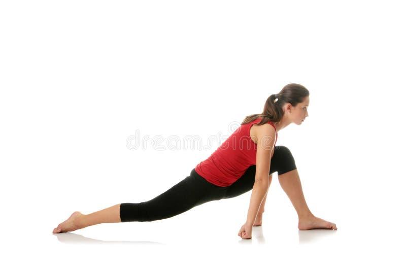 Femme faisant étirant l'exercice photographie stock