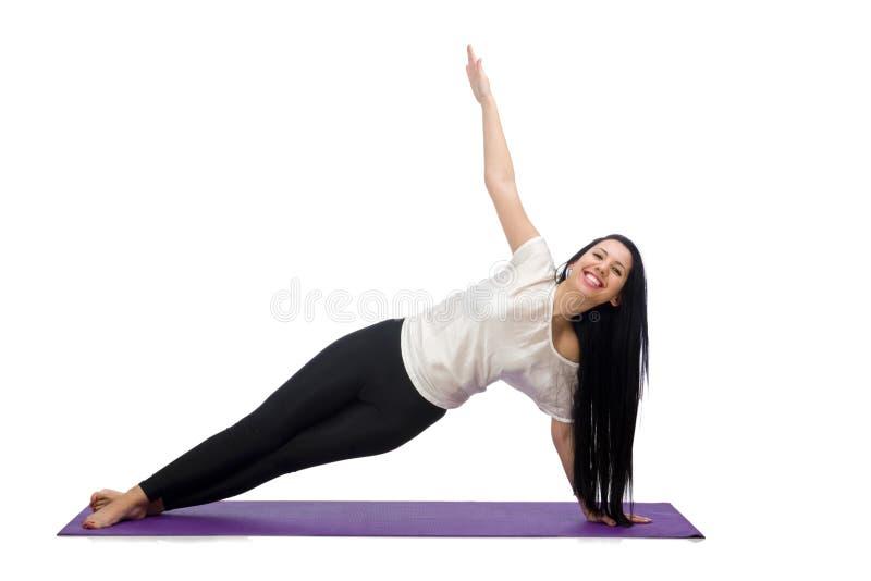 Femme faisant des exercices sur le blanc images stock