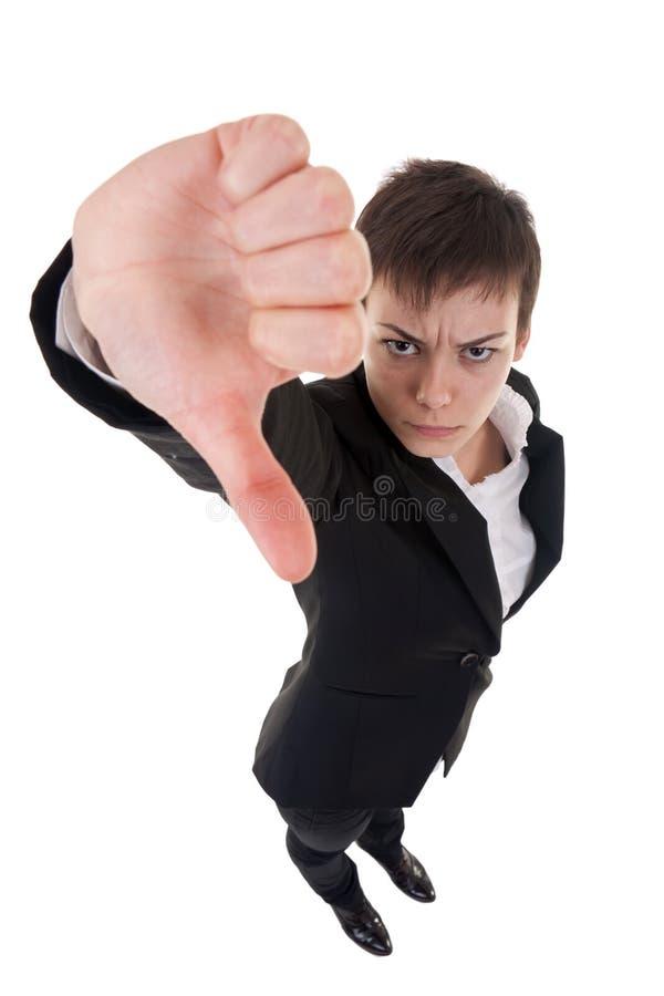 Femme faisant des gestes des pouces vers le bas photo stock