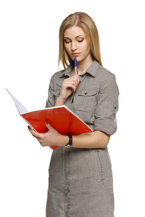 Femme faisant des notes photographie stock