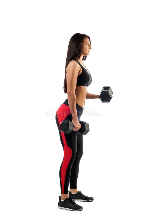 Femme faisant un exercice sur le biceps photo libre de droits