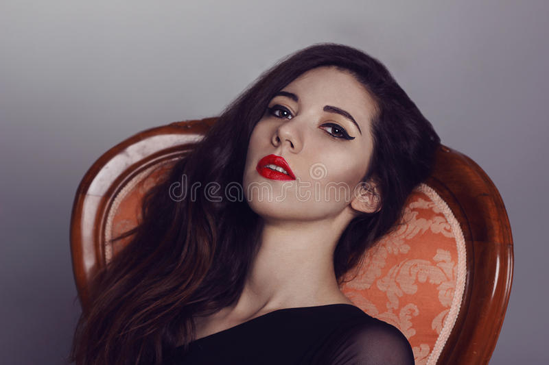 Femme fatale. woman with fashion makeup. Black arrows and royalty free stock photos