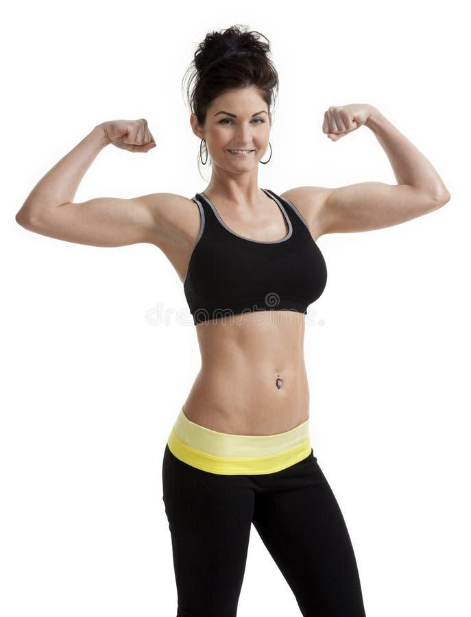 Femme fière de forme physique image libre de droits