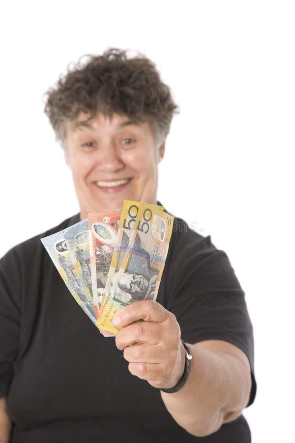 Femme gagnant l'argent merveilleux photos stock