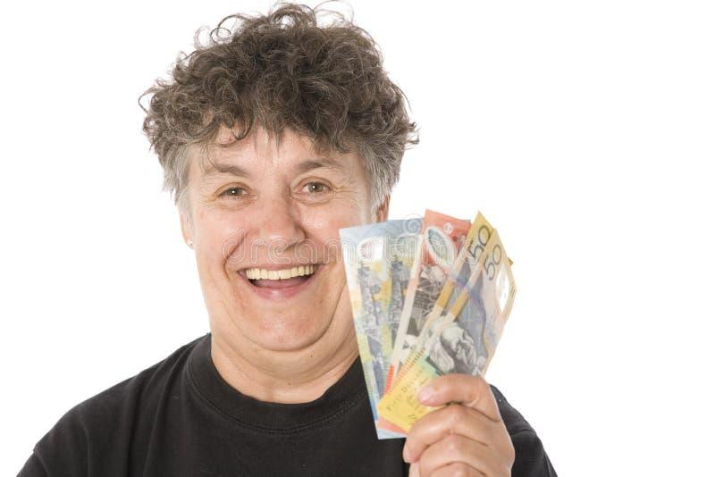 Femme gagnant l'argent merveilleux image stock